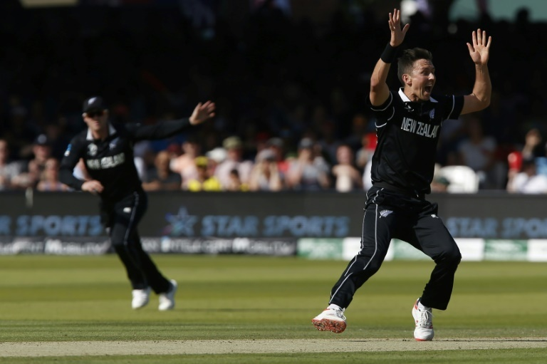 New Zealand's Trent Boult celebrates the wicket of Australia's Jason Behrendorff. ─ AFP