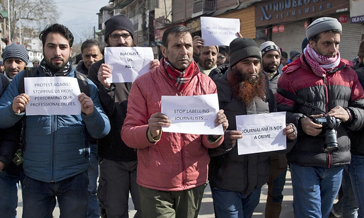 Kashmiri journalists hold placards during a protest march in Srinagar on January 26, 2019 after authorities barred at least half a dozen journalists from entering the venue of India's Republic Day parade in the disputed region's main city. — AP