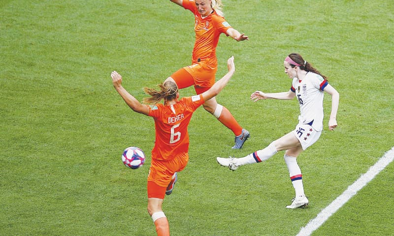 LYON: Rose Lavelle of the United States (R) shoots to score during the Women's World Cup final at the Stade de Lyon.—AP