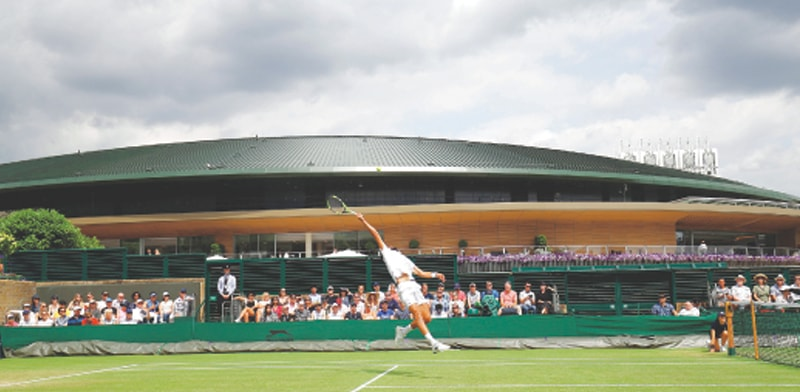 LONDON: France's Benoit Paire leaps for a return during the Wimbledon fourth-round match against Roberto Bautista Agut of Spain at the All England Lawn Tennis Club on Monday.—AFP