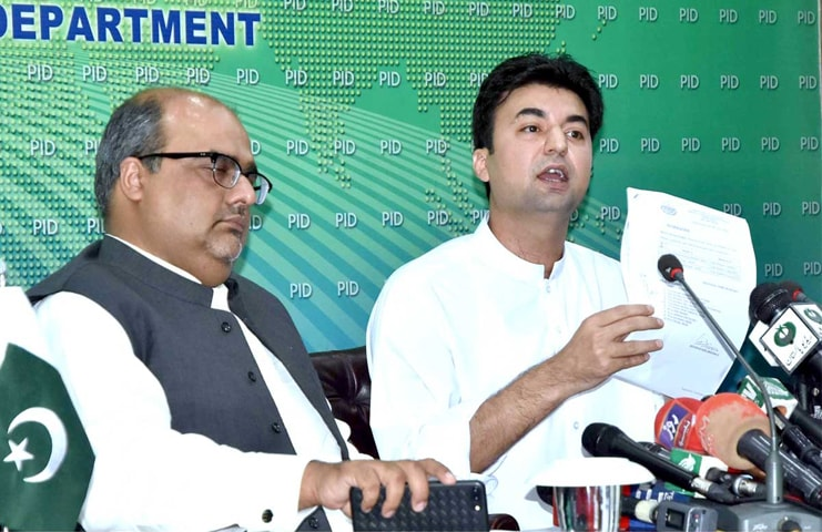ISLAMABAD: Communications Minister Murad Saeed and Special Assistant to the Prime Minister on Accountability Shahzad Akbar pictured during a press conference on Monday. — APP