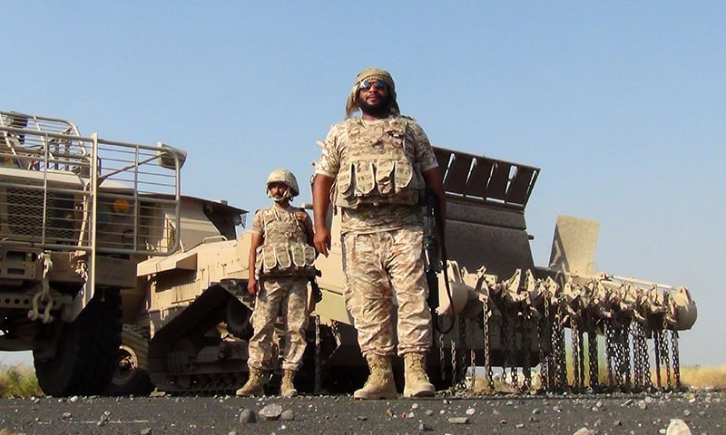 In this file photo taken on October 04, 2015 Emirati soldiers, taking part in the Saudi-led operations against Yemeni Houthi rebels, stand during rehabilitation and demining operations at the al-Anad airbase in the southern Lahj governorate, some 50 kilometres north of the Red Sea port of Aden.  — AFP
