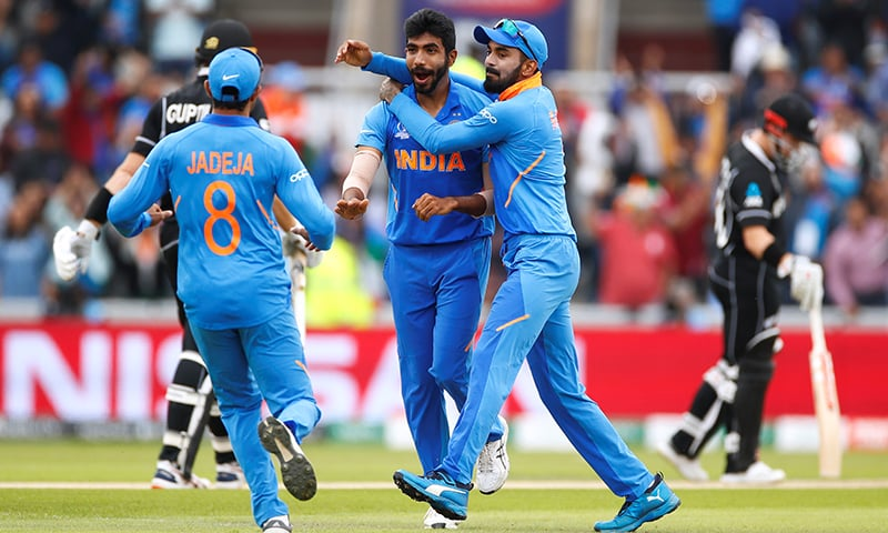 India's Jasprit Bumrah celebrates after taking the wicket of New Zealand's Martin Guptill. — Reuters