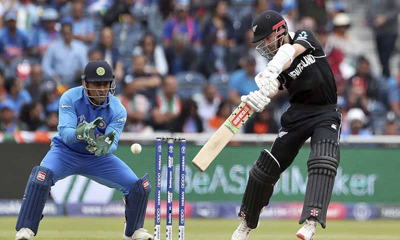 New Zealand's captain Kane Williamson, right, bats during the Cricket World Cup semi-final match between India and New Zealand at Old Trafford on July 9. — AP