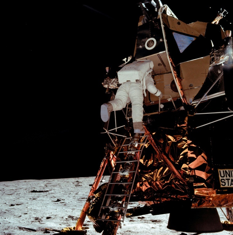 "US astronaut Buzz Aldrin climbs down the ladder from the lunar module ""Eagle,"" 15 minutes after Neil Armstrong on July 21, 1969. ─ AFP"