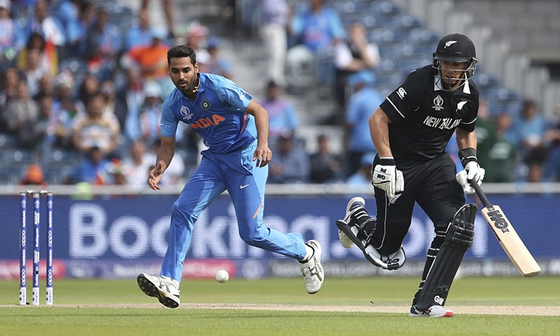 India's Bhuvneshwar Kumar, left, runs to field the ball after a shot played by New Zealand's Tom Latham during the Cricket World Cup semi-final match between India and New Zealand at Old Trafford in Manchester, England on Wednesday. — AP