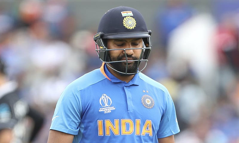 India's Rohit Sharma reacts as he leaves the field after being dismissed by New Zealand's Matt Henry during the Cricket World Cup semi-final match between India and New Zealand at Old Trafford in Manchester on July 10.— AP
