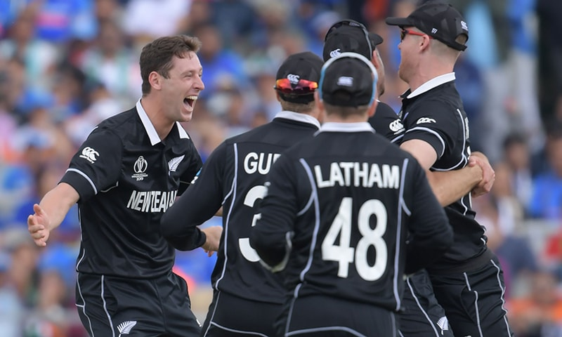 New Zealand's Matt Henry (L) celebrates taking the wicket of India's Dinesh Karthik during the 2019 Cricket World Cup first semi-final between New Zealand and India at Old Trafford in Manchester on July 10. — AFP