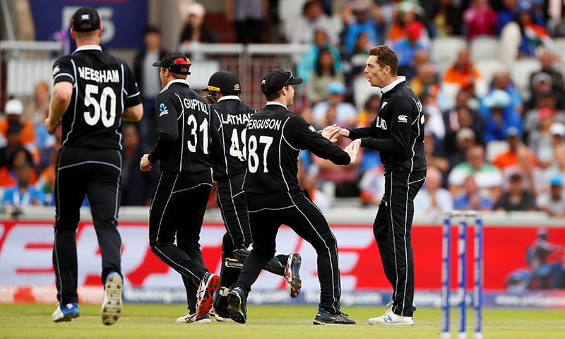 New Zealand's Mitchell Santner celebrates with team mates after taking the wicket of India's Hardik Pandya in World Cup semi-final on July 10. — Reuters