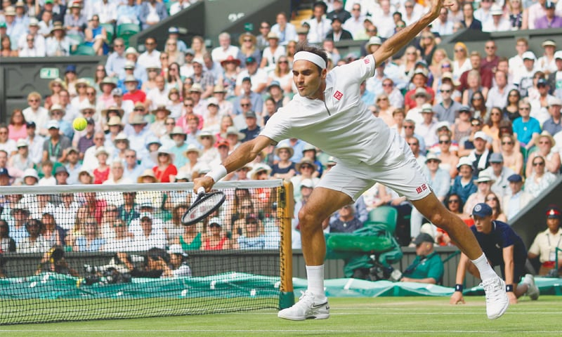 SWITZERLAND'S Roger Federer hits a return to Kei Nishikori of Japan during their quarter-final.—AFP