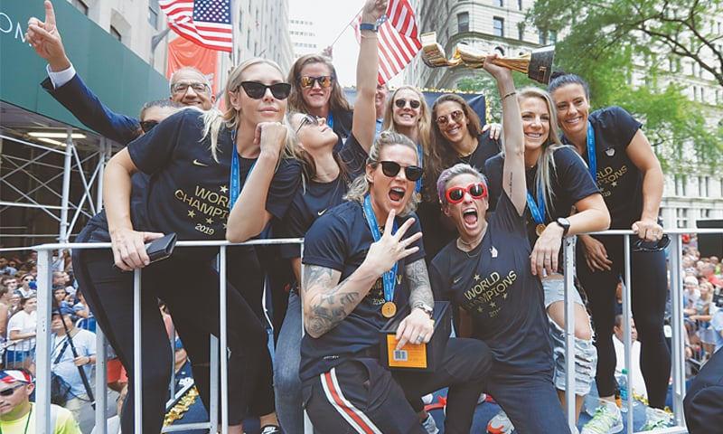 NEW YORK: Megan Rapinoe holds the Women's World Cup trophy as the US team celebrates with a parade along the Canyon of Heroes on Wednesday.—AP