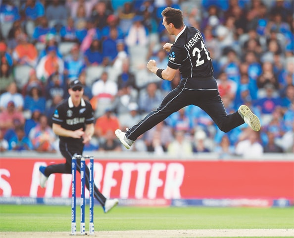 NEW ZEALAND paceman Matt Henry celebrates after dismissing Rohit Sharma on Wednesday.—Reuters
