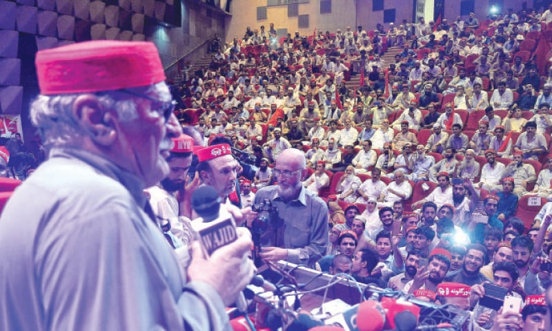 ANP chief Asfandyar Wali Khan addresses the participants at the first anniversary of Haroon Bilour at Nishtar Hall, Peshawar, on Wednesday. — White Star