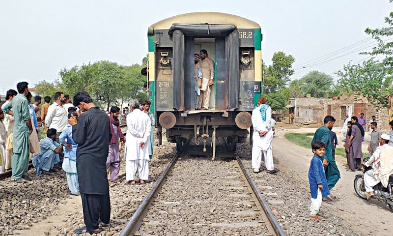 MULTAN: Passengers of the detached coaches of the Pakistan Express await repairs that took more than two hours before the train resumed its journey. — Dawn