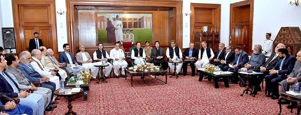 KARACHI: Prime Minister Imran Khan holds a meeting with a delegation of the business community here on Wednesday. — APP