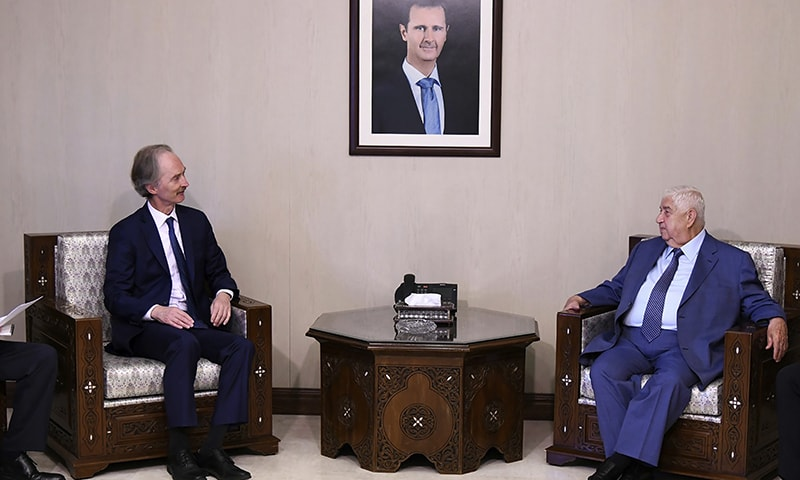 In this photo released by the Syrian official news agency SANA, the UN's special envoy for Syria Geir Pedersen, left, meets with Syrian foreign minister Walid Moallem, in Damascus, Syria on Wednesday. — SANA via AP