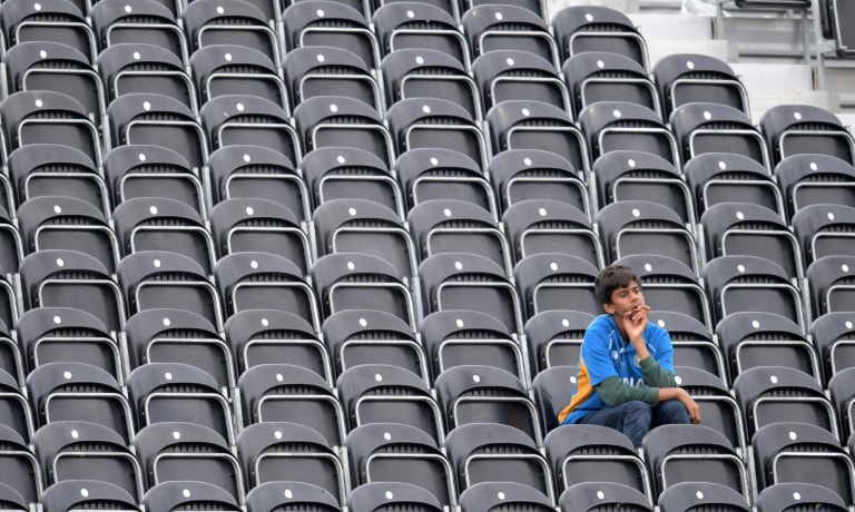 An India fan reacts at the end of play during the 2019 Cricket World Cup first semi-final between New Zealand and India at Old Trafford in Manchester, northwest England, on Wednesday. — AFP