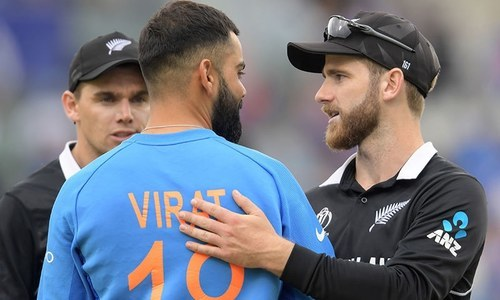 New Zealand captain Kane Williamson greets India's captain Virat Kohli at the end of the match. — AFP