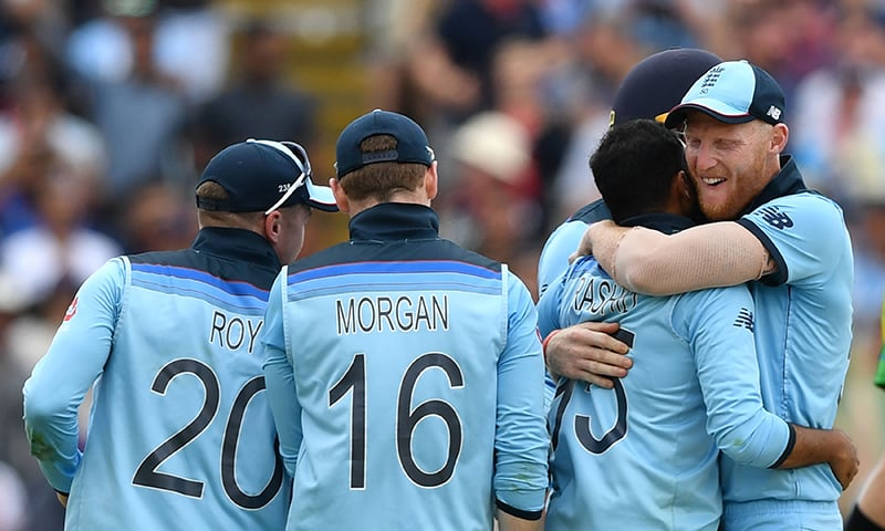 England's Adil Rashid (2R) celebrates with England's Ben Stokes (R) after dismssing Australia's Marcus Stoinis for a duck during World Cup second semi-final between England and Australia at Edgbaston on July 11. — AFP