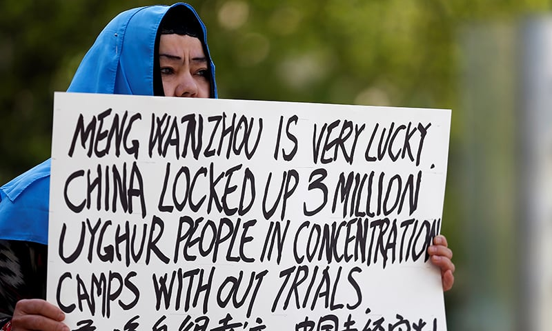 A protester, Dilibair Yusuf, holds a sign protesting China's treatment of Uighur people in the Xinjiang region during a court appearance by Huawei's Financial Chief Meng Wanzhou, outside of British Columbia Supreme Court building in Vancouver, Canada on May 8, 2019. — Reuters