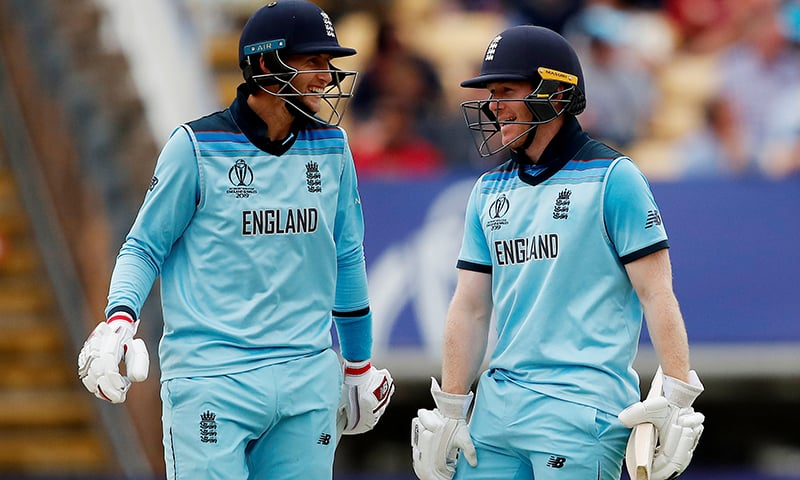 England's Eoin Morgan and Joe Root celebrate after the match. — Reuters
