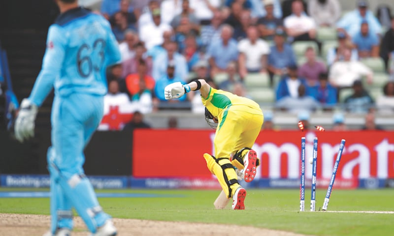 BIRMINGHAM: Australian batsman Steve Smith is run out by England wicket-keeper Jos Buttler during their semi-final at Edgbaston on Thursday.—Reuters