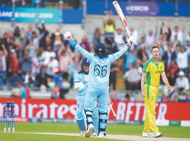 England's Eoin Morgan and Joe Root celebrate after their victory in the semi-final.—Reuters