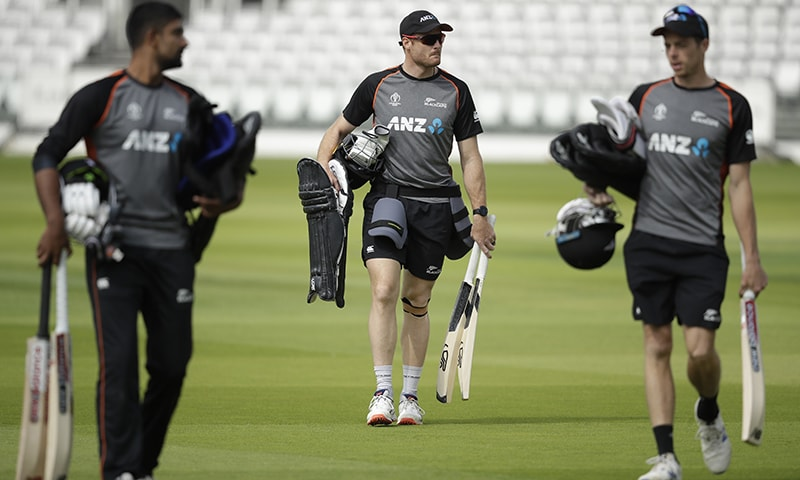 New Zealand's Martin Guptill, centre, arrives for a practice session ahead of the Cricket World Cup final match between England and New Zealand at Lord's cricket ground in London on July 12. — AP