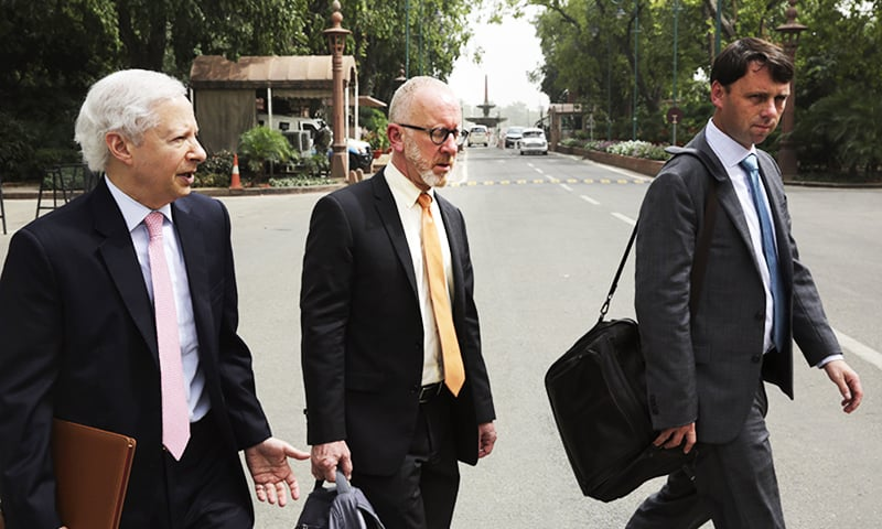 US Ambassador to India Kenneth Juster, left, arrives with Assistant US Trade Representative for South and Central Asia Christopher Wilson, center, and Brendan Lynch, right, for a meeting with officials of the Indian Ministry for Trade and Industry at the parliament house in New Delhi, India.—AP