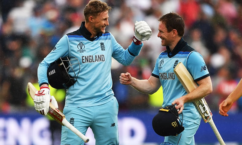 England's captain Eoin Morgan (R) and England's Joe Root celebrate victory at close of play during the 2019 Cricket World Cup second semi-final between England and Australia at Edgbaston in Birmingham, central England,  on July 11. — AFP