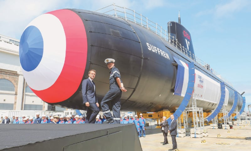 "French President Emmanuel Macron (left) attends the official launch ceremony of the new French nuclear submarine ""Suffren"" in Cherbourg, north-western France on Friday.—AFP"