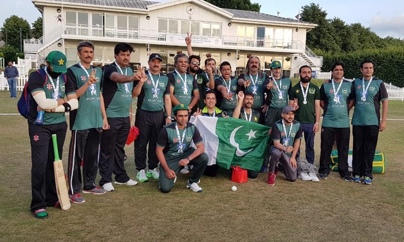The Pakistan parliamentary cricket team pose with their medals. — Photo: Twitter
