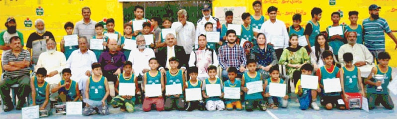 KARACHI: Participating children from the basketball summer coaching camp are seen here with DC South Salahuddin Ahmed and other KBBA officials at the Arambagh courts on Friday.