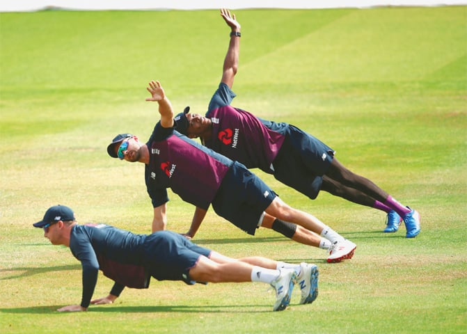 ENGLAND trio of Jofra Archer, Mark Wood and Jos Buttler stretch out at Lord's on Saturday.—Reuters