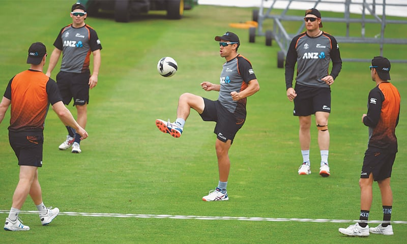 ROSS Taylor (C) plays football with his New Zealand team-mates as they take part in a training session.—AFP