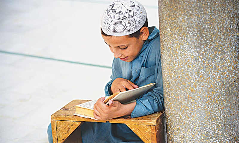 A boy reads the Quran in a seminary | File photo