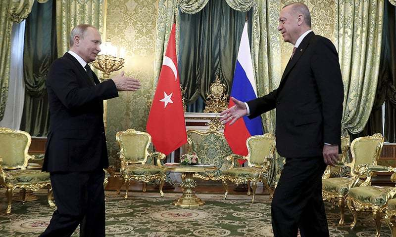 This file photo shows Russia's President Vladimir Putin, left, walking to shake hands with Turkey's President Recep Tayyip Erdogan, right, as he welcomes him prior to their meeting in Moscow, Russia on April 8. — AP