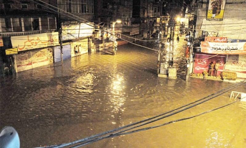 Streets in Rawalpindi's Purana Qila area inundated following heavy rain early Saturday. — Photo by Mohammad Asim
