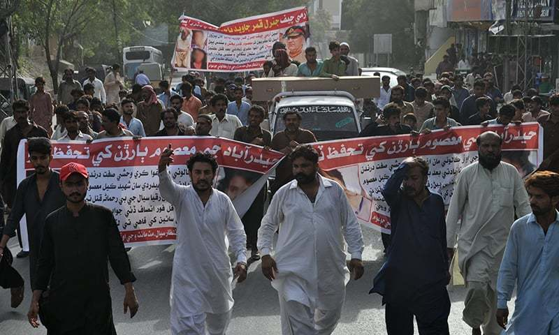 Members and supporters of the bereaved family stage a rally along with the girl's coffin in Hyderabad on Thursday to seek justice. — Photo by Mohammad Hussain Khan/File
