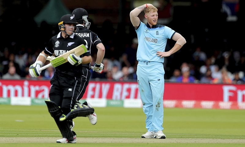 England's Ben Stokes (R), reacts after a boundary hit by New Zealand's James Neesham, center, during the World Cup final match between England and New Zealand at Lord's on July 14. — AP