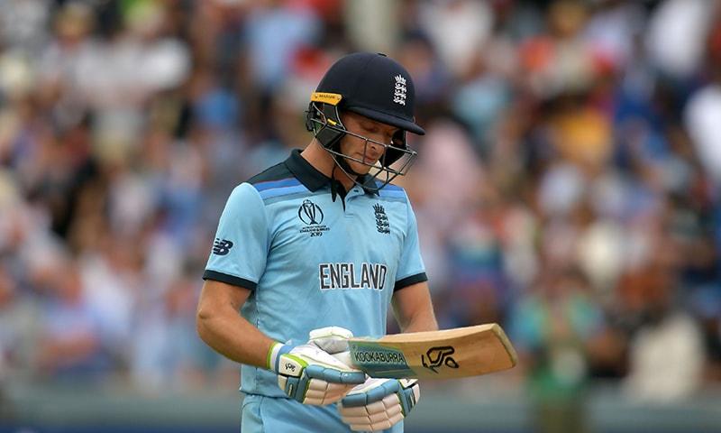 England's Jos Buttler walks back to the pavilion after his dismissal. — AFP