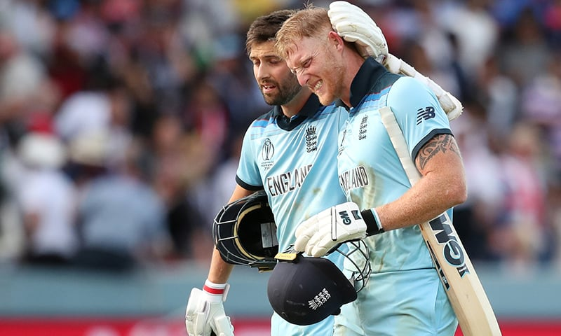 England's Ben Stokes and Mark Wood before the super over. — Reuters