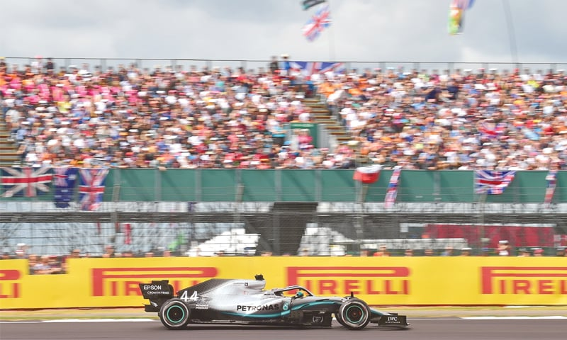 SILVERSTONE: Mercedes' Lewis Hamilton of Britain drives during the British Formula One Grand Prix at the Silverstone motor racing circuit on Sunday.—AFP
