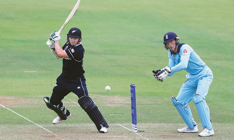 LONDON: New Zealand's Tom Latham cuts as England wicket-keeper Jos Buttler looks on during the final at Lord's on Sunday.—AP