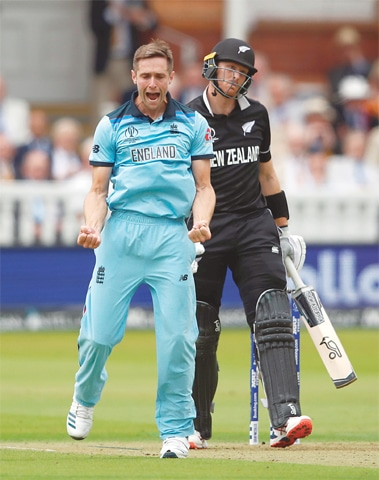 ENGLAND seamer Chris Woakes is overjoyed after dismissing New Zealand opener Martin Guptill.—Reuers