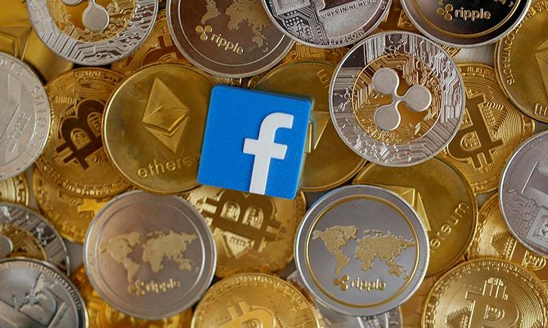 A 3-D printed Facebook logo is seen on representations of virtual currencies in this illustration picture on June 18. — Reuters/File