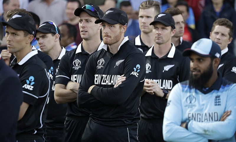 New Zealand's Martin Guptill, center, waits for the trophy presentation after losing the Cricket World Cup final match between England and New Zealand at Lord's cricket ground in London on Sunday. — AP
