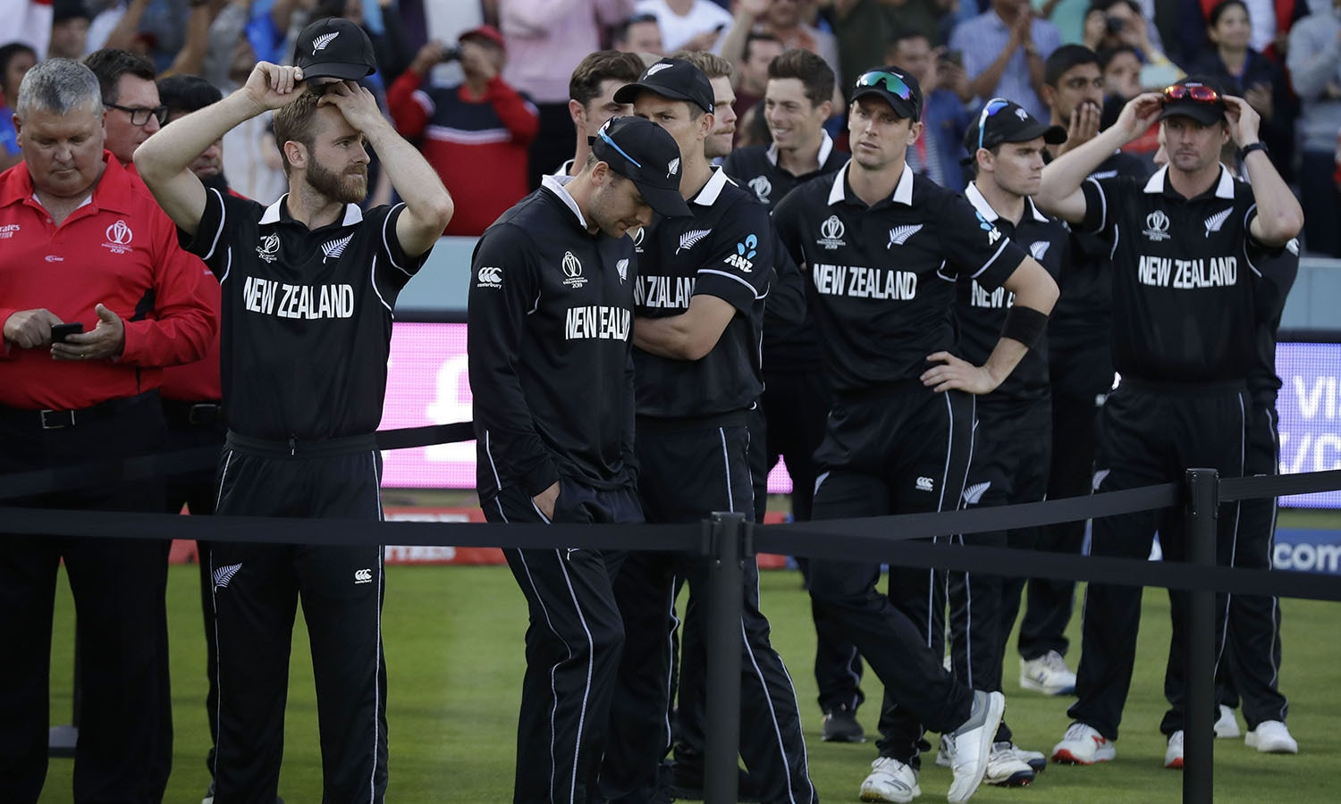 New Zealand's captain Kane Williamson stands with his players as he waits for the trophy presentation after losing the Cricket World Cup final match between England and New Zealand. — AP