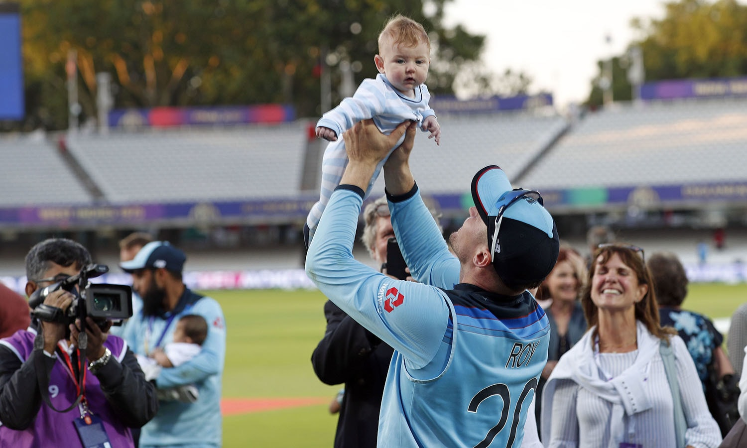 Jason Roy holds up a baby after winning the Cricket World Cup final match between England and New Zealand at Lord's. — AP