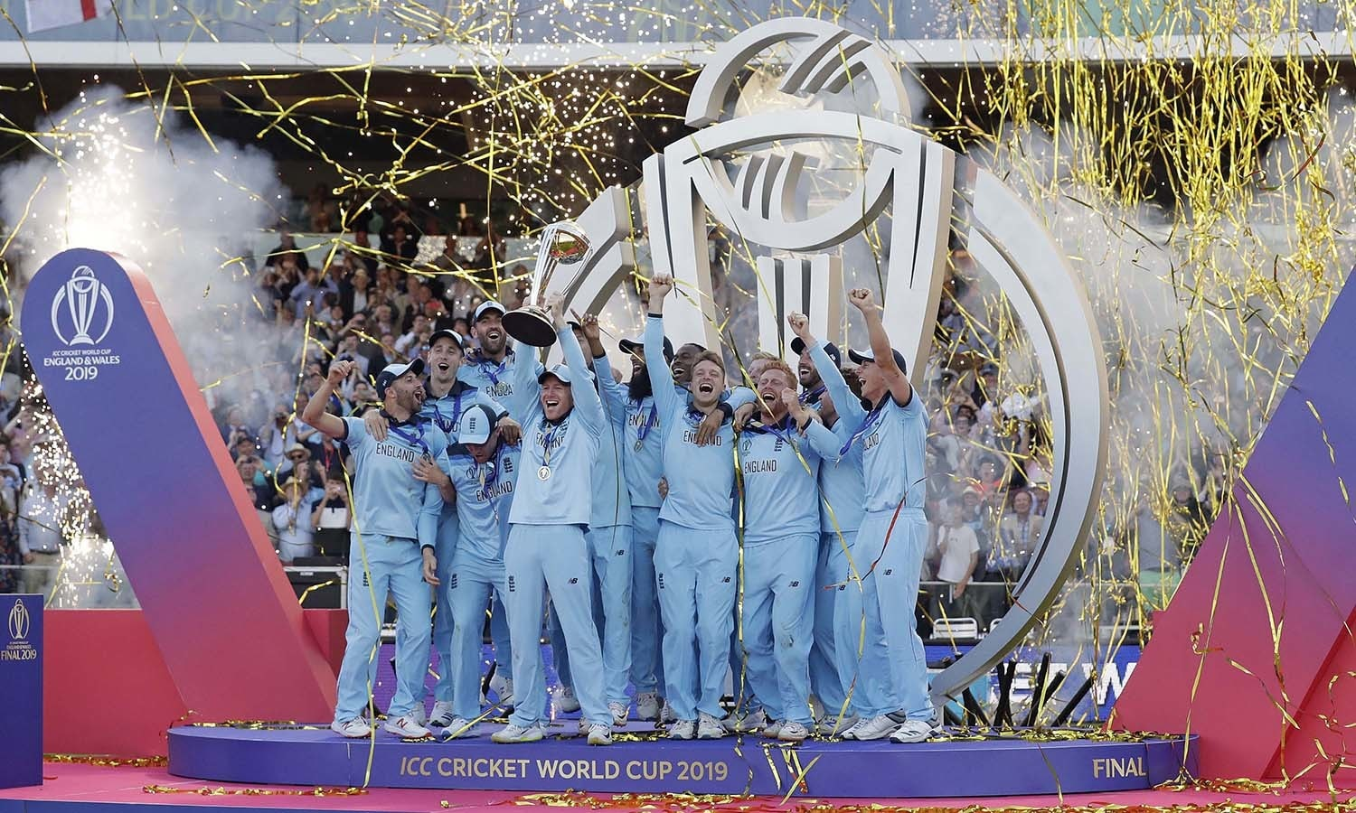 England's captain Eoin Morgan raises the trophy after winning the Cricket World Cup final. — AP